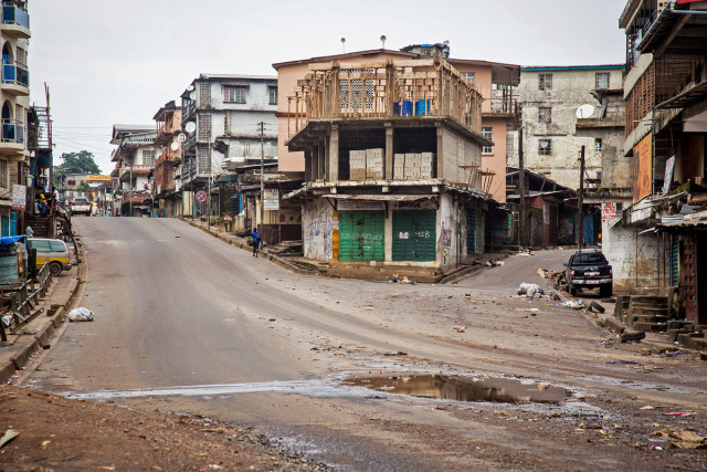 Empty streets are seen, as Sierra Leone government enforces a three day lock down on movement of all people in an attempt to fight the Ebola virus, in Freetown, Sierra Leone, Friday, Sept. 19, 2014. Thousands of health workers began knocking on doors across Sierra Leone on Friday in search of hidden Ebola cases with the entire West African nation locked down in their homes for three days in an unprecedented effort to combat the deadly disease. (AP Photo/ Michael Duff)
